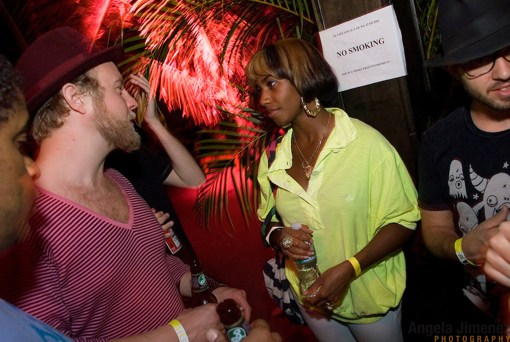 Date: 6/19/08.Desk: STL.Slug: NITE.Assign Id: 30063895A..Santi White, center in yellow, aka the singer Santigold, talks with, from left, Jamal Van Sluytman of the band No Surrender, Johan Karlberg of the band Radio Clit, Lee Williams of No Love Lost Records and DJ Franki Chan at Studio B in Greenpoint, Brooklyn on June 19, 2008. ....Photo by Angela Jimenez for The New York Times .photographer contact 917-586-0916