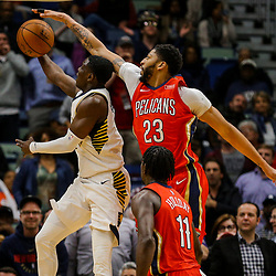 Mar 21, 2018; New Orleans, LA, USA; Indiana Pacers guard Darren Collison (2) shoots as New Orleans Pelicans forward Anthony Davis (23) and guard Jrue Holiday (11) defend during the second half at the Smoothie King Center. The Pelicans defeated the Pacers 96-92. Mandatory Credit: Derick E. Hingle-USA TODAY Sports