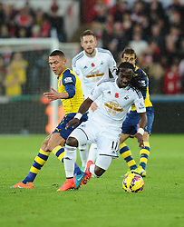 Swansea City's Marvin Emnes is fouled by Arsenal's Kieran Gibbs  - Photo mandatory by-line: Joe Meredith/JMP - Mobile: 07966 386802 - 09/11/2014 - SPORT - Football - Swanswa - Liberty Stadium - Swansea City v Arsenal - Barclays Premier League