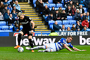 Ezgjan Alioski (10) of Leeds United rides the challenge of Chris Gunter (2) of Reading during the EFL Sky Bet Championship match between Reading and Leeds United at the Madejski Stadium, Reading, England on 10 March 2018. Picture by Graham Hunt.