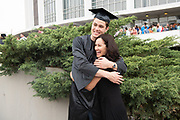 Kameron Hensley hugs his mom, Paula Hensley following spring undergraduate commencement. Photo by Ben Siegel