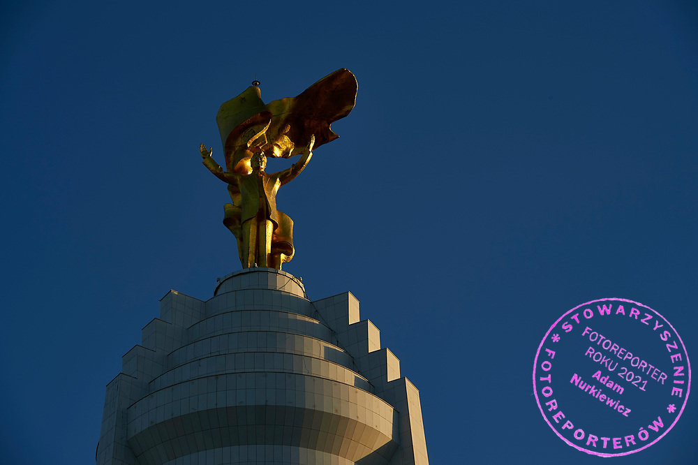 Ashgabat, Turkmenistan - 2017 September 22: A view of the Monument of Neutrality, topped by a 12-metre tall gold-plated statue of the first Turkmen president Saparmurat Niyazov while sunset during 2017 Ashgabat 5th Asian Indoor & Martial Arts Games on September 22, 2017 in Ashgabat, Turkmenistan.<br /> <br /> Mandatory credit:<br /> Photo by © Adam Nurkiewicz<br /> <br /> Adam Nurkiewicz declares that he has no rights to the image of people at the photographs of his authorship.<br /> <br /> Picture also available in RAW (NEF) or TIFF format on special request.<br /> <br /> Any editorial, commercial or promotional use requires written permission from the author of image.