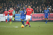 AFC Wimbledon striker Tom Elliott (9) battles for possesion with Charlton Athletic defender Jorge Teixeira (50) during the EFL Sky Bet League 1 match between AFC Wimbledon and Charlton Athletic at the Cherry Red Records Stadium, Kingston, England on 11 February 2017. Photo by Matthew Redman.