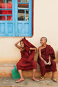 Shy young Monks hiding and having fun, Heho