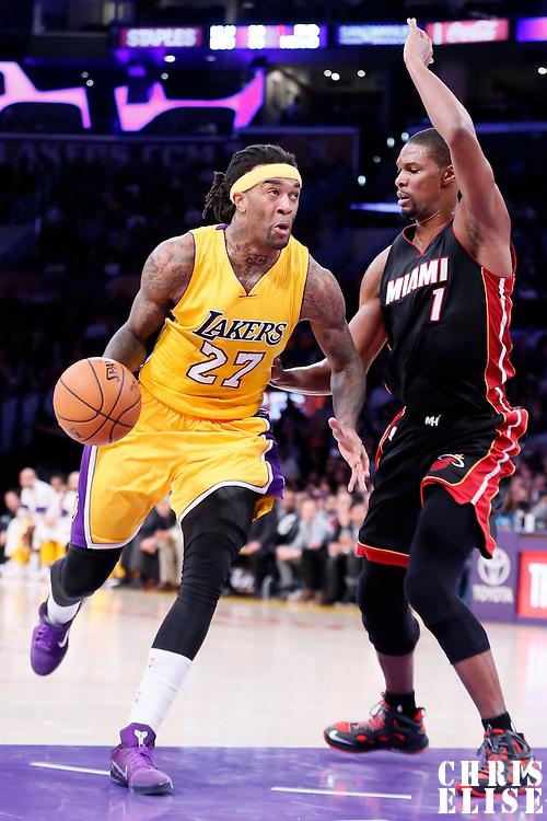 13 January 2014: Los Angeles Lakers center Jordan Hill (27) drives past Miami Heat center Chris Bosh (1) during the Miami Heat 78-75 victory over the Los Angeles Lakers, at the Staples Center, Los Angeles, California, USA.