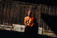 A portrait of an older monk at a monastery in Mandalay, Myanmar.