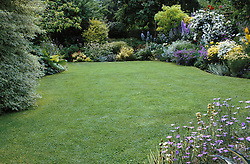 Well kept lawn and borders at Eastgrove Cottage, Worcestershire