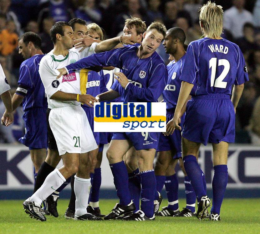 Photo:  Frances Leader.<br /> <br /> Millwall v Ferencvaros. UEFA cup first round first leg.<br /> The New Den<br /> 19/09/2004<br /> <br /> Ferencvaros' Dragan Vukmir slaps Millwalls Neil Harris after a disagreement on the pitch over a tackle<br /> NORWAY ONLY