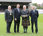 Dundee managing director John Nelms (second left) presents a quaich to retired Black Watch commander Lieutenant General Sir Alistair Irwin, also in the picture are Lord Provost Bob Duncan and Dundee director Bob Hynd<br />