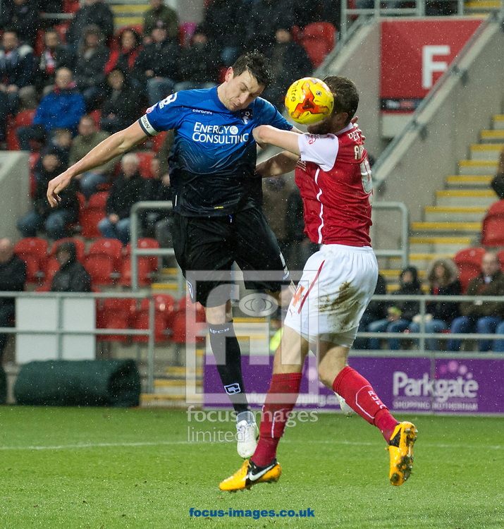 Tommy Elphick of Bournemouth (left) scores to make it 1-0 to his team during the Sky Bet Championship match at the New York Stadium, Rotherham<br /> Picture by Russell Hart/Focus Images Ltd 07791 688 420<br /> 17/01/2015