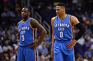 Feb 8, 2016; Phoenix, AZ, USA; Oklahoma City Thunder guard Russell Westbrook (0) talks with guard Dion Waiters (3) during the game against the Phoenix Suns at Talking Stick Resort Arena. Mandatory Credit: Jennifer Stewart-USA TODAY Sports