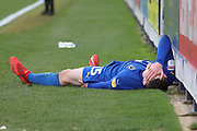 AFC Wimbledon defender Steve Seddon (15) down injured during the EFL Sky Bet League 1 match between AFC Wimbledon and Doncaster Rovers at the Cherry Red Records Stadium, Kingston, England on 9 March 2019.