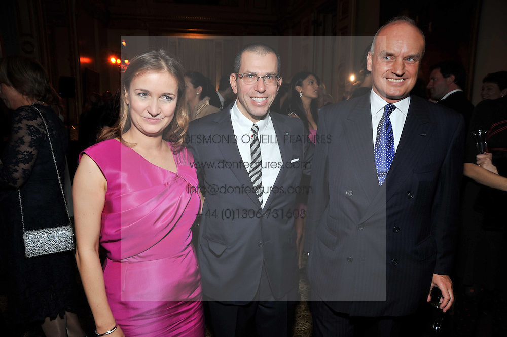 Left to right, CATHERINE OSTLER, JONATHAN NEWHOUSE and NICHOLAS COLERIDGE at a party to celebrate 300 years of Tatler magazine held at Lancaster House, London on 14th October 2009.