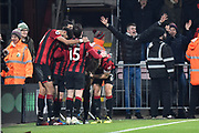 Goal - Callum Wilson (13) of AFC Bournemouth is mobbed as hew celebrates after he scores a goal to give a 3-0 lead during the Premier League match between Bournemouth and Brighton and Hove Albion at the Vitality Stadium, Bournemouth, England on 21 January 2020.