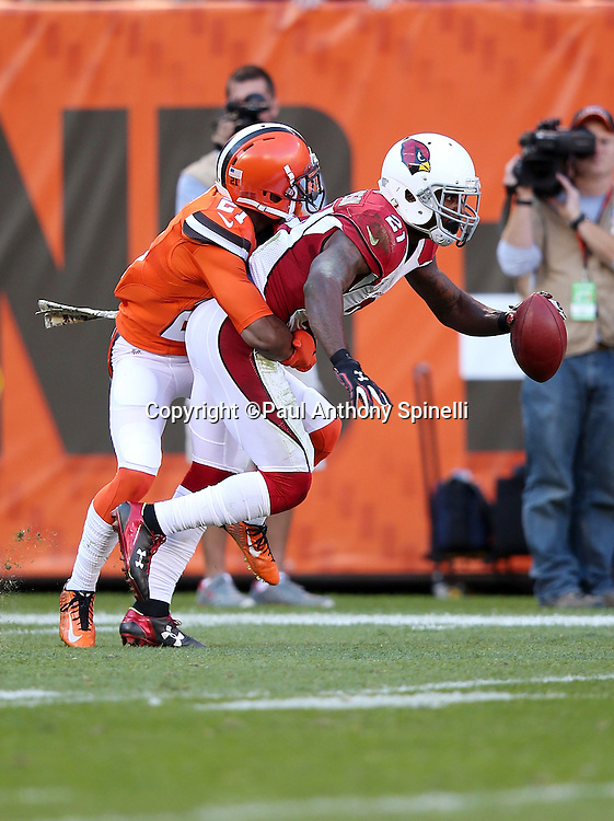 Arizona Cardinals cornerback and punt returner Patrick Peterson (21) gets tackled by Cleveland Browns cornerback Justin Gilbert (21) as he returns a punt during the 2015 week 8 regular season NFL football game against the Cleveland Browns on Sunday, Nov. 1, 2015 in Cleveland. The Cardinals won the game 34-20. (©Paul Anthony Spinelli)