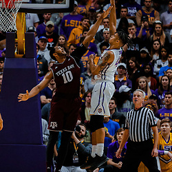 Jan 23, 2018; Baton Rouge, LA, USA; LSU Tigers forward Wayde Sims (44) shoots over Texas A&M Aggies center Tonny Trocha-Morelos (10) during the first half at the Pete Maravich Assembly Center. Mandatory Credit: Derick E. Hingle-USA TODAY Sports