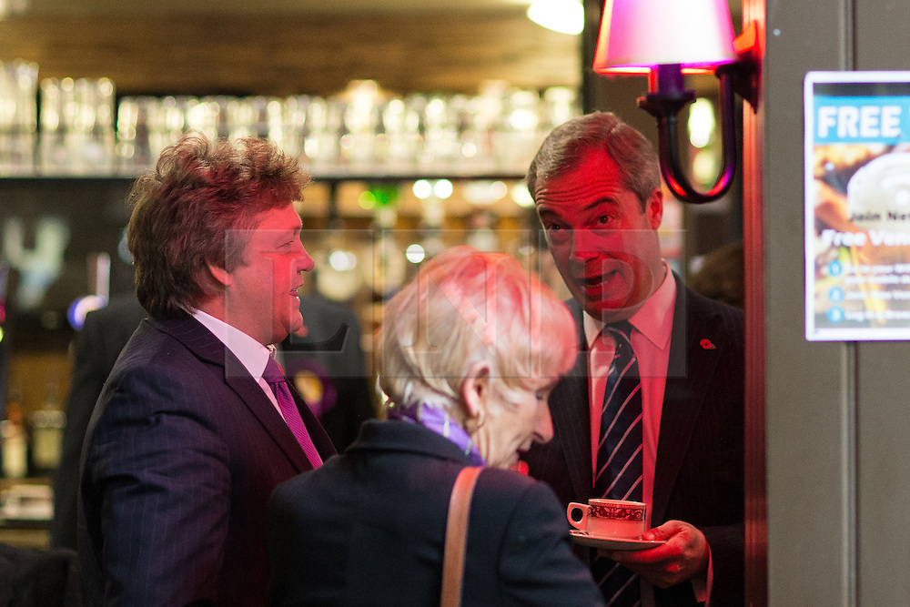 © Licensed to London News Pictures . 03/11/2015 . Oldham , UK . NIGEL FARAGE talking with party activists at the launch of the UKIP campaign for the seat of Oldham West and Royton , at the Railway Hotel in Royton . The by-election has been triggered by the death of MP Michael Meacher . Photo credit : Joel Goodman/LNP