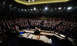 January 30, 2018 - Washington, District of Columbia, United States of America - President Donald Trump looks towards Republicans giving him a standing ovation as Democratic members of Congress remain seated during U.S. President Donald Trump delivers his State of the Union Address to a joint session of the U.S. Congress at the Capitol in Washington, U.S. January 30, 2018.  .Credit: Jim Bourg / Pool via CNP (Credit Image: © Jim Bourg/CNP via ZUMA Wire)