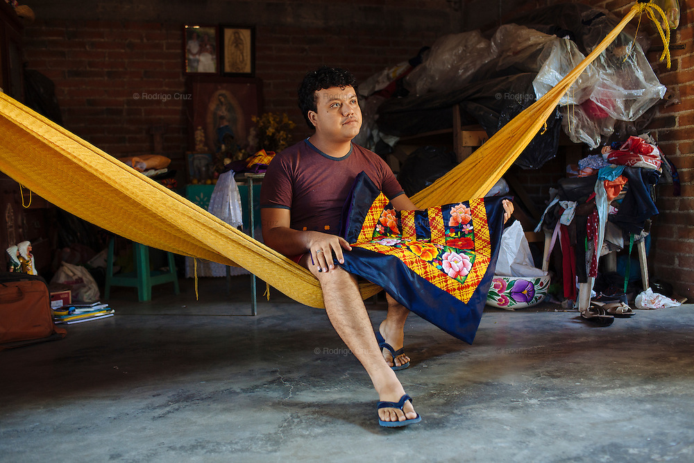 "Angelo Martinez Linares, 24, in Juchitán, Mexico.<br /> <br /> In Juchitán in the southern state of Oaxaca, Mexico, the world is not divided simply into gay and straight, the locals make room for a third category, whom they call ""muxes"".<br /> <br /> Muxes are men who consider themselves women and live in a socially sanctioned netherworld between the two genders. ""Muxe"" is a Zapotec word derived from the Spanish ""mujer"" or woman; it is reserved for males who, from boyhood, have felt themselves drawn to living as a woman, anticipating roles set out for them by the community.<br /> <br /> They are considered hard workers that will forever stay by their mothers side, taking care for their families operating as mothers without children of their own.<br /> <br /> Not all muxes express they identities the same way. Some dress as women and take hormones to change their bodies. Others favor male clothes. What they share is that the community accepts them."