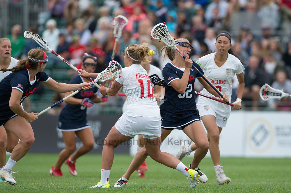 England's  Annie Miller challenges with USA's Allysomn Miller at the 2017 FIL Rathbones Women's Lacrosse World Cup, at Surrey Sports Park, Guildford, Surrey, UK, 15th July 2017.