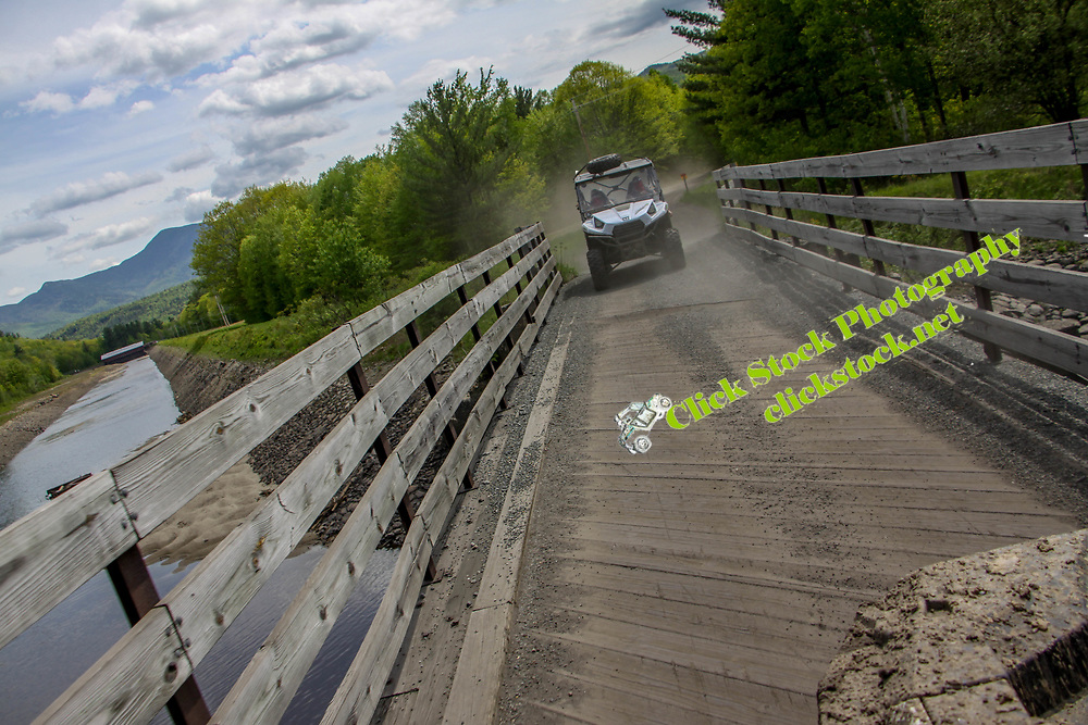 UTV on bridge over river in New England, bridge, New England, NH, New Hampshire, atv, utv, sxs, ohrv, orv, trail riding, hobby, adventure, sports, therapy, Click Stock Photography