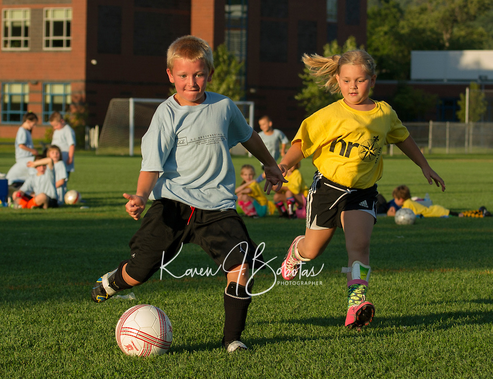 Landon Boremes of GC Engineering takes a shot to the goal during U8 Laconia Youth Soccer at Opechee Park on Wednesday evening.  (Karen Bobotas/for the Laconia Daily Sun)