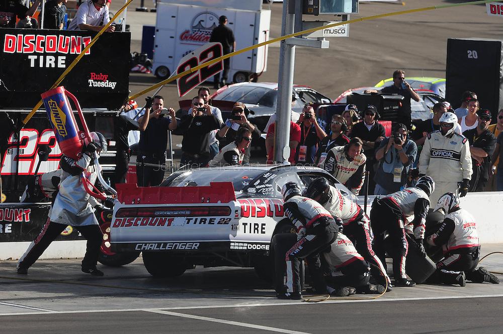 Nov. 12 2011; Avondale, AZ, USA; NASCAR Nationwide Series driver Brad Keselowski (22) pits during the Wypall 200 at Phoenix International Raceway. Mandatory Credit: Jennifer Stewart-US PRESSWIRE
