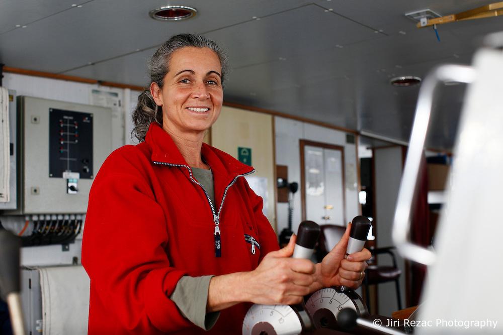 ATLANTIC OCEAN ABOARD ESPERANZA 20JUN11 – Captain Madeleine Habib of Australia on the bridge of the Greenpeace ship Esperanza...Photo by Jiri Rezac / Greenpeace