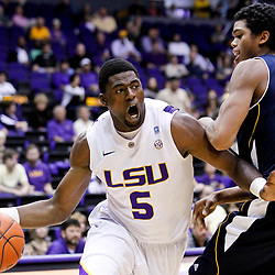 December 15, 2011; Baton Rouge, LA; LSU Tigers forward Malcolm White (5) drives past UC Irvine Anteaters forward Will Davis II (3) during the first half of a game at the Pete Maravich Assembly Center.  Mandatory Credit: Derick E. Hingle-US PRESSWIRE