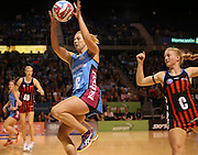 Stacey Peters of the Steel gathers the ball with Chloe Williamson of the Tactix in defence during the ANZ Championship Netball game between the Tactix v Steel at Horncastle Arena in Christchurch. 6th April 2015 Photo: Joseph Johnson/www.photosport.co.nz