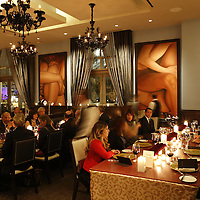 Cartier party enjoying dinner at Morton's Steakhouse .