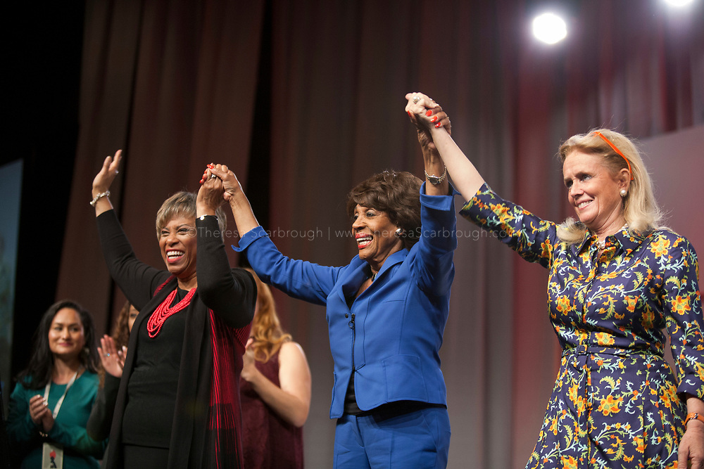 Detroit, Michigan, USA. 28th Oct, 2017. (L-R) Congresswoman Brenda Lawrence, Congresswoman Maxine Waters, and Congresswoman Debbie Dingell , raise hands at the end of the Sojourner Truth Lunch during the Women's Convention held at the Cobo Center, Detroit Michigan, Saturday, October 28, 2017