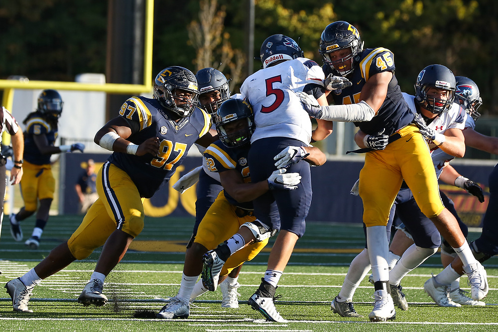 October 7, 2017 - Johnson City, Tennessee - William B. Greene Jr. Stadium: ETSU defensive lineman Tremond Ferrell (97), ETSU linebacker Zack Yancey (22), ETSU defensive lineman Nasir Player (45)<br /> <br /> Image Credit: Dakota Hamilton/ETSU