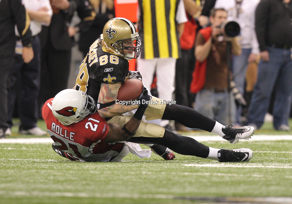 16 January 2010: New Orleans Saints tight end Jeremy Shockey (88) is tackled by Arizona Cardinals safety Antrel Rolle (21) during a 45-14 win by the New Orleans Saints over the Arizona Cardinals in a 2010 NFC Divisional Playoff game at the Louisiana Superdome in New Orleans, Louisiana.