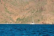 Campers on the beach and an anchored sailboat, Ensenada Grande, Isla Partida, La Paz, BCS, Mexico; Jan 2010