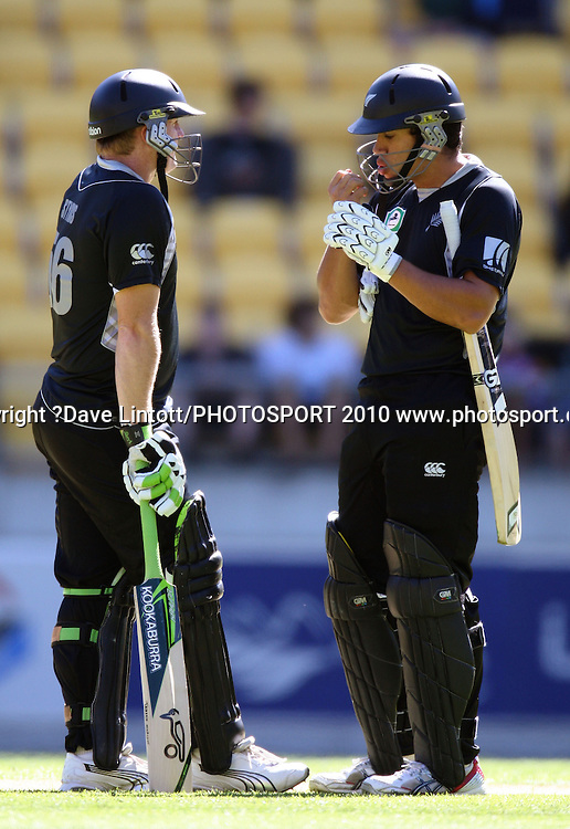 NZ's Ross Taylor blows on his injured hand as Scott Styris looks on.<br /> Fifth Chappell-Hadlee Trophy one-day international cricket match - New Zealand v Australia at Westpac Stadium, Wellington. Saturday, 13 March 2010. Photo: Dave Lintott/PHOTOSPORT