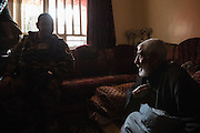 Elderly resident, Mohammed Gasem of the Khadra housing complex which was liberated from ISIS only hours earlier speaks with an Iraqi Army officer. Mosul, Iraq. Nov. 26, 2016. (Photo by Gabriel Romero ©2016)