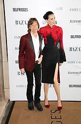 Mick Jagger; L'Wren Scott, Harper's Bazaar Women of the Year Awards, Claridge's Hotel, London UK, 05 November 2013, Photo by Richard Goldschmidt © Licensed to London News Pictures. Photo credit : Richard Goldschmidt/Piqtured/LNP