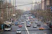 Fulbright fellow Joel Eisen in Beijing. Traffic in the San Li Tun areaof Beijing.