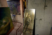 Artist Jon Sarkin is reflected in a mirror he is using to paint a self portrait in his basement studio. Sarkin suffered a strange cerebral hemorrhage and stroke which resulted in the removal of half his cerebellum. He has a completely different personality and an absolute compulsion to make art.