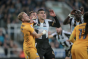 Aleksandar Mitrović (Newcastle United) pulls Tom Clarke's (Preston North End) shirt when rising to head the ball from a corner during the EFL Cup 4th round match between Newcastle United and Preston North End at St. James's Park, Newcastle, England on 25 October 2016. Photo by Mark P Doherty.