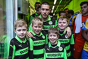 Forest Green Rovers Liam Noble(15) with the mascots during the Vanarama National League match between Forest Green Rovers and Torquay United at the New Lawn, Forest Green, United Kingdom on 1 January 2017. Photo by Shane Healey.