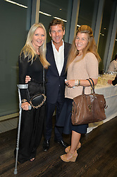 Left to right, AMANDA WAKELEY, HUGH MORRISON and AMBER NUTTALL at the YOO 15 Anniversary Party hosted by John Hitchcox and Philippe Starck at Bankside, SE1 on 17th September 2014