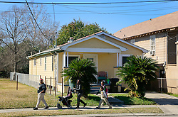 28 January 2015. New Orleans, Louisiana.<br /> The humble house on Whitney Avenue, New Orleans where Gayle Benson grew up. Built in the 1940's by Gayle's father Francis Lajaunie. Gayle Benson is the 3rd and current wife of Louisiana billionaire Tom Benson, owner of the NFL football team The New Orleans Saints and NBA basketball team The New Orleans Pelicans. <br /> Photo; Charlie Varley/varleypix.com