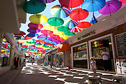 Brightly coloured umbrellas cover a street in Fethiye, Turkey.