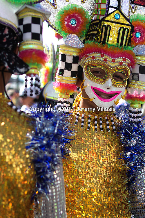 Young boy in a colorful costume during the 32nd Masskara Festival in Bacolod City, the Philippines.