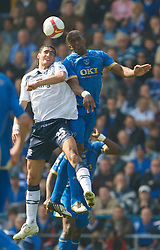 PORTSMOUTH, ENGLAND - Saturday, March 21, 2009: Everton's Marouane Fellaini and Portsmouth's Sylvain Distin during the Premiership match at Fratton Park. (Photo by David Rawcliffe/Propaganda)