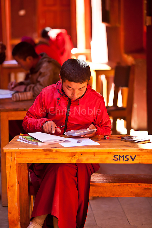 A young monk takes an exam at the Shree Mahakaruna Sakyapa School in lo Manthang, Upper Mustang, Nepal.