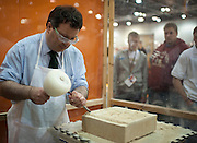 Dr. Stephen Farry Employment and Learning Minister for Northern Ireland visits the ExCel Centre and trys his hand a Stone Masonry in London on October 8th 2011.