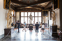 FLORENCE, ITALY - 29 JUNE 2016: Visitors are here at the Uffizi Gallery in Florence, Italy, on June 29th 2016.<br /> <br /> Art historian Eike Schmidt, former curator and head of the Department of Sculpture, Applied Art and Textiles at the Minneapolis Institute of Arts, became the first non-Italian director of the Uffizi in August 2015, replacing Antonio Natali who directed the gallery for 9 years. One of the main goals of the new director is to open the Vasari Corridor to the general public. Currently the corridor can only be visited with group reservations made by external tour and travel agencies throughout the year.<br /> <br /> The Vasari Corridor is is a 1-kilometer-long (more than half mile) elevated enclosed passageway which connects the Palazzo Vecchio with the Palazzo Pitti, passing through the Uffizi Gallery and crossing the Ponte Vecchio above the Arno River, in Florence. The passageway was designed and built in 1564 by Giorgio Vasari in only 6 months to allow Cosimo de' Medici and other Florentine elite to walk safely through the city, from the seat of power in Palazzo Vecchio to their private residence, Palazzo Pitti. The passageway contains over 1000 paintings, dating from the 17th and 18th centuries, including the largest and very important collection of self-portraits by some of the most famous masters of painting from the 16th to the 20th century, including Filippo Lippi, Rembrandt, Velazquez, Delacroix and Ensor.